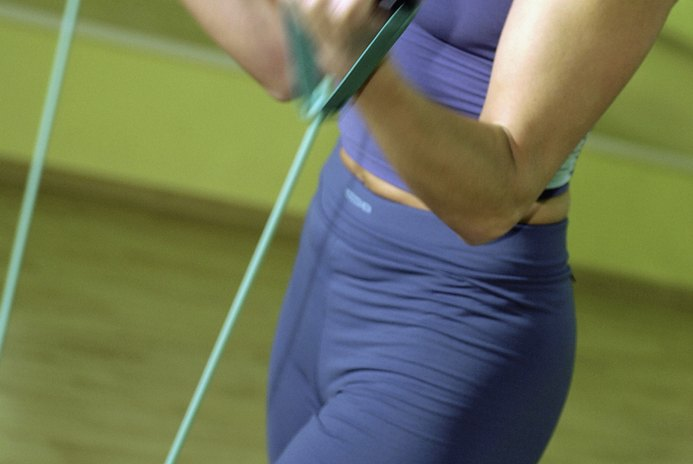 How to Lose Arm Fat With Resistance Bands