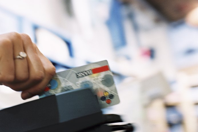 does charging credit on your debit card count towards your credit score