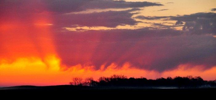 Bright colors paint the sky - sunrises in south dakota