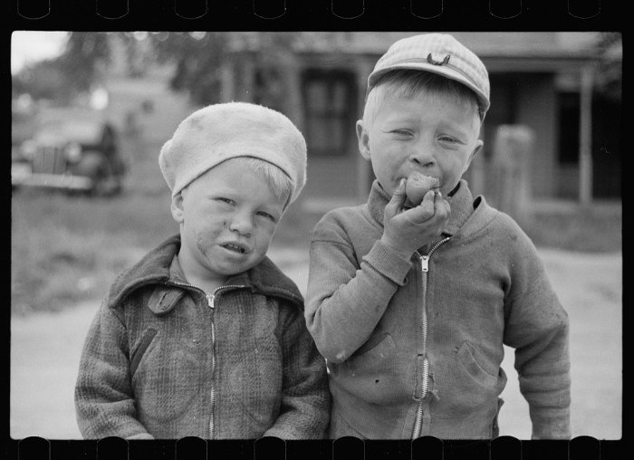 In Sisseton, in 1939, these two boys were photographed towards the end of the Great Depression.