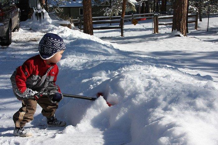 kid shoveling snow