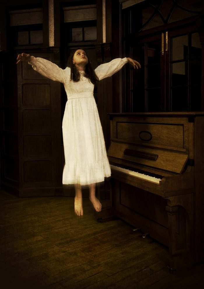 hovering girl at piano