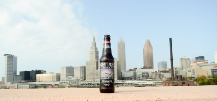 Great Lakes Christmas Ale in front of Cleveland skyline