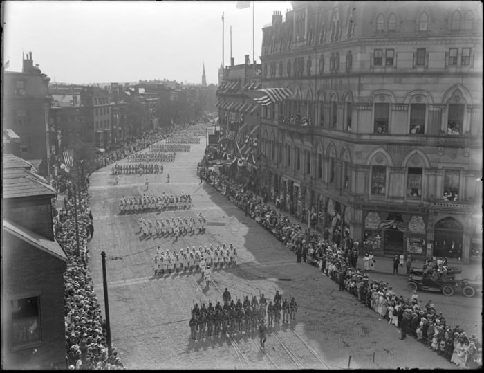 6b80ca4b6fa78e 2. During 1917, WWI was ongoing. This image shows servicemen in the U.S.  Army and Navy marching through Boston.
