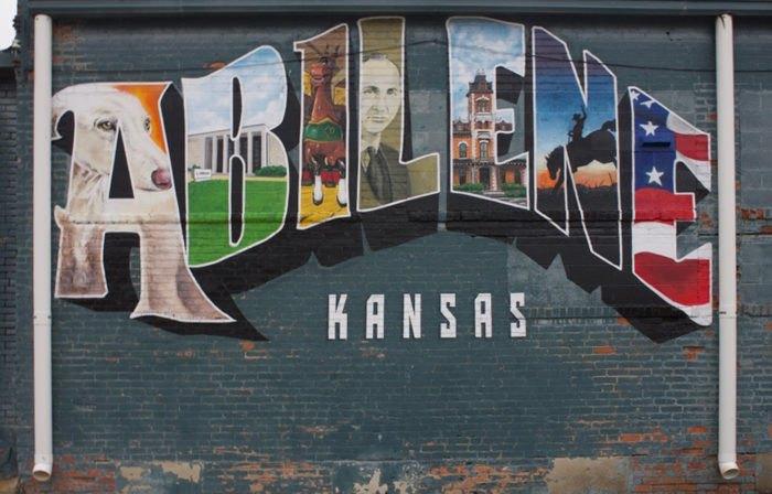 A painted Abilene, Kansas mural similar to a postcard.