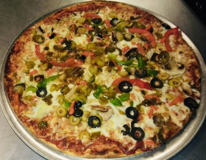 An all veggie pizza with jalepenos and both kinds of olives.