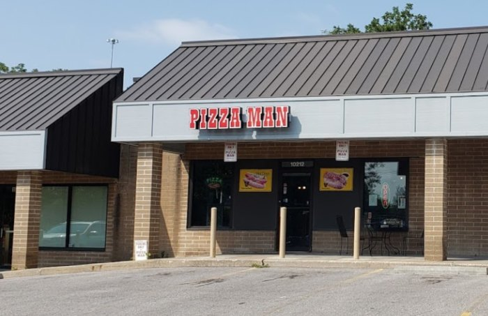 A view of the front of the restaurant, that says Pizza Man in large red letters.