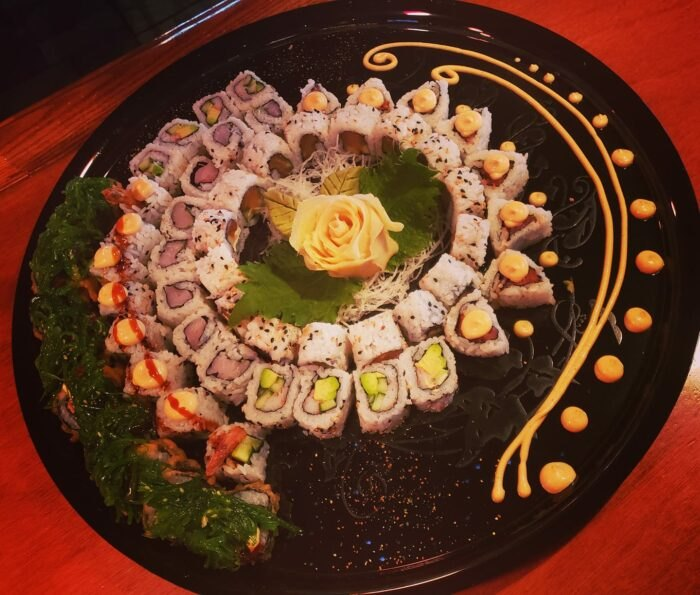 a plate full of sushi arranged in a circle