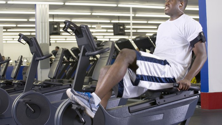 Both an elliptical machine and a recumbent bike provide you with a low-impact cardiovascular workout that burns calories and helps build lean muscle mass. These machines use similar muscle groups, but there are unique advantages to each machine, so chose the one that best suits your personal fitness needs.