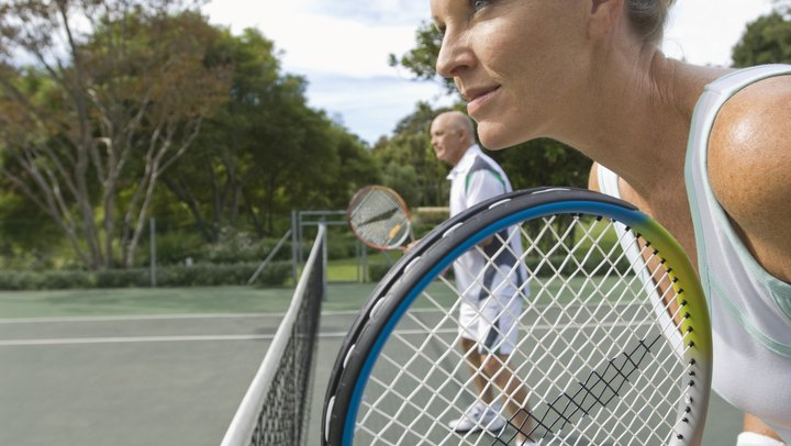 Doubles is the most popular form of tennis for club-level players, and with four people on the court, many variables can occur. Although playing doubles can simply be four people on the court playing singles, there is more to a true doubles game than that. Drills for tennis doubles allow players to learn various doubles strategies and to practice them before matches.