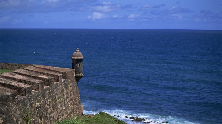 With its white-sand beaches, unique and diverse culture, lively night life and impressive historical monuments, Puerto Rico is a great destination for tourists year round. If you're interested in avoiding extreme weather, big crowds or peak-season pricing, however, you should take a few factors into consideration before planning your trip. High season is between mid December and late April, when the weather is mild and the island celebrates several important holidays, but low season also has some advantages in terms of pricing and a calmer traveling experience.