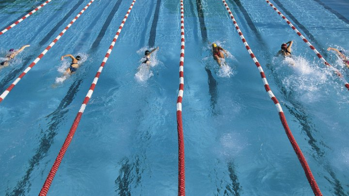 Calculating split times in swimming is a means of calculating an individual swimmer's or relay team's pace over a series of laps. Recording splits and calculating times is useful in determining what legs of the race are covered in what amount of time. A timer can record a split after one lap -- the length of the pool; two laps -- down and back -- or any other distance he chooses. A split is the exact second that divides one lap from another. Split time is the amount of time that adds up between two splits.