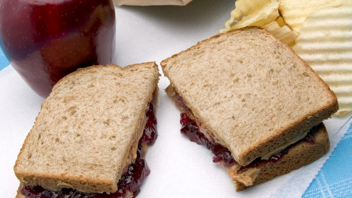 A crowd-pleaser for kids and adults alike, peanut butter and jelly sandwiches make up a staple of the American diet. While you might be more apt to choose PB&J sandwiches for their convenience and affordability, they also provide a source of essential vitamins and minerals. For a healthful peanut butter and jelly sandwich, go for all-natural peanut butter and whole wheat bread made without added sugar.