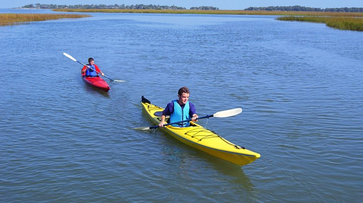 "Kayaking is an excellent total-body exercise, requiring power from both the torso and legs to propel the kayak forward. Caloric expenditure in any activity depends on a variety of factors, including total muscle mass, the intensity and duration of the exercise and your body's basal metabolic rate. However, according to ""Essentials of Strength Training and Conditioning,"" kayaking ranks among the more physically demanding physical activities, which include cross country skiing, running, and rowing."