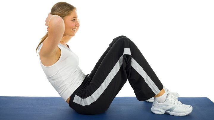 Probably the best known abdominal exercise is the sit-up. This move targets your rectus abdominis, but a number of other muscles are also involved, from your abdomen all the way down to your ankles. However, any time you think of sit-ups and six-pack abs, you are picturing your rectus abdominis. When performing a sit-up, you bring you entire back off the floor as you raise your upper body toward your knees. A similar move, the crunch, involves lifting only your upper back off the floor.