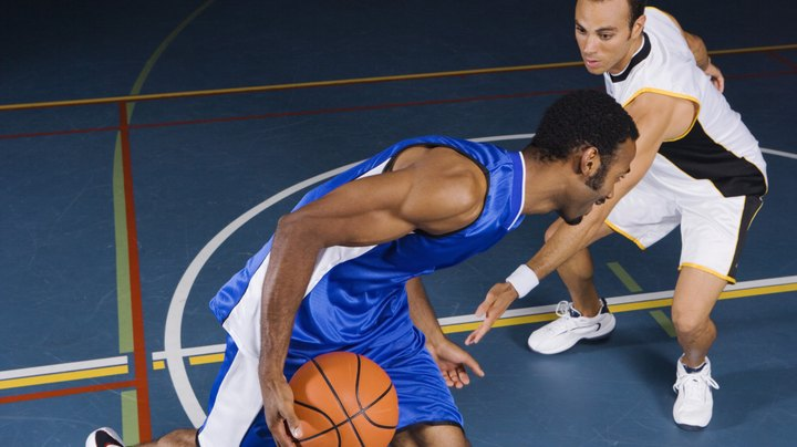 An important part of engaging in any physical activity is going through a warm-up routine before beginning. This can be especially important in basketball, as the quick, explosive stops and starts and sharp cuts you make when playing can put a lot of stress on the muscles, ligaments and tendons in your legs. Completing a pregame warm-up does just that -- warms your body up -- reducing your chances of injury by tearing tissues in your legs. It can also help you mentally, as a pregame warm-up can sharpen your focus for the game. Incorporate basketball-specific drills into your pregame-warm-up routine that can get your muscles loose at the same time that you're sharpening your game skills.