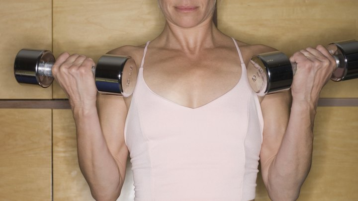 How to Even Out Your Arm Muscles. Uneven symmetry throughout your body is normal, but shouldn't interfere with day-to-day activities or exercise. Your arms may develop larger muscles on your dominant side. This occurs because you often use that arm to carry groceries, reach for high objects and push or pull items during the day. In most cases, the problem is slight, but a muscle imbalance could result in an injury. Proper training allows you to even out the muscles in your arms and helps counteract a disproportionate look. Talk to your doctor before starting a new exercise program.