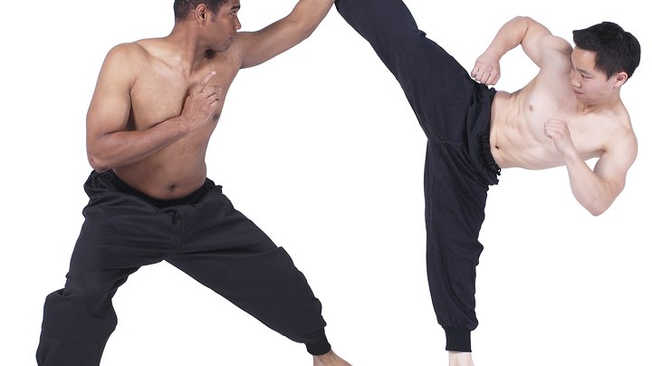Nothing is quite as iconic in the martial arts as the art of kicking. All martial arts styles have punches, and many of them include joint locks, grappling and other self-defense techniques, but kicks combine skill, finesse and power to impressive effect. The shin and instep are two of the most common areas to strike with when kicking, but both require different approaches. Understanding when to strike and how hard to strike with the shin and instep makes all the difference in the effectiveness of the technique and the risk of injury to you.