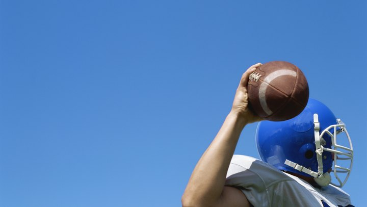 On many football teams, the quarterback's right -- or occasionally left -- arm is the primary offensive weapon. As the quarterback, it's your job to take care of that arm, to keep it healthy, and to strengthen it as much as possible. As a football player, you have a variety of exercises at your disposal to help build your arm strength so you can pass your team to victory.