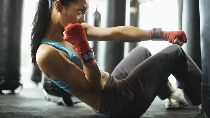 Elite boxers have a reputation for having outstanding physiques. Some might even have more visible abdominal muscles than they do teeth. While there is no magical shortcut to success, adapting your boxing workout to target your abdominals can get you looking and performing like a champ.