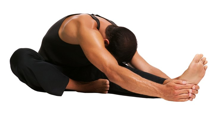 The sit and reach is a fitness test that measures the flexibility of your hamstrings, lower back and glutes. To perform the test, sit on the floor with your legs extended out in front of you and your feet against the edge of a sit-and-reach box. With arms extended out in front of you, slowly bend forward at the waist and use your fingers to press the tab atop the box as far forward as possible. To improve the sit-and-reach test, participate in a static flexibility program that specifically targets the hamstrings, lower back and glutes.