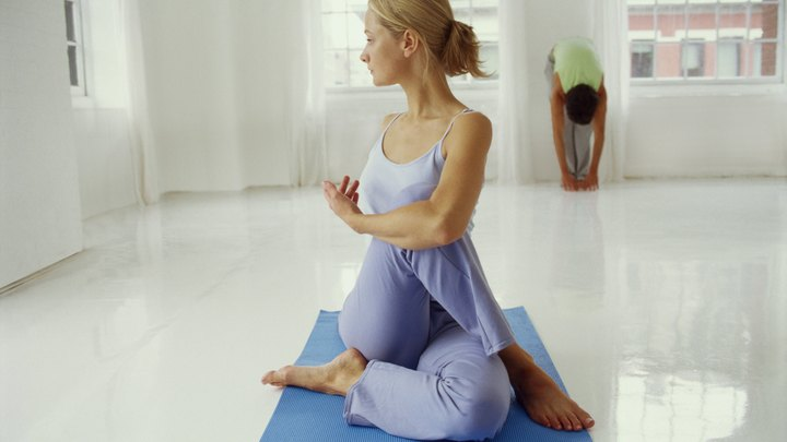 According to experienced practitioners, yoga can reverse signs of physical aging. Still, it's easy to be intimidated by the pretzel-like poses seen on the covers of yoga publications. While you may never achieve poses that resemble those of circus acrobats, easier postures can improve your overall well-being. For beginners, a simple seated twist known as Ardha Matsyendrasana in Sanskrit provides a comfortable way to benefit from the practice.