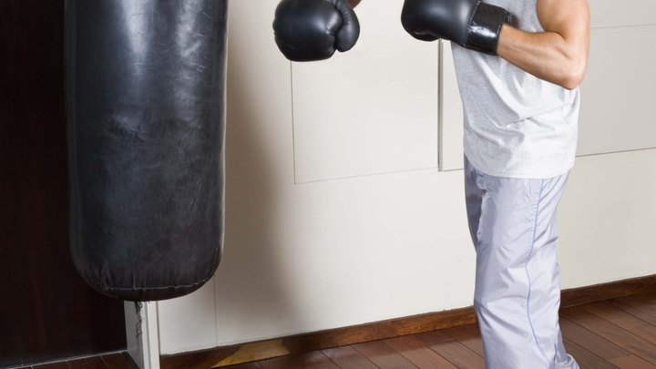 Even if you don't have any dreams of getting into the ring, practicing boxing is an effective way to burn calories, tone your muscles and develop a skill that can increase your confidence. Not everyone has a boxing club in close proximity, but if your only option is to work out at home, you can practice simple drills to hone your skills.