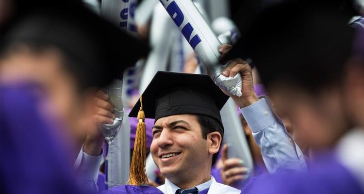 A graduate celebrating at a commencements ceremony.