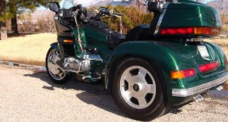 Adapt a motorcycle into a trike.