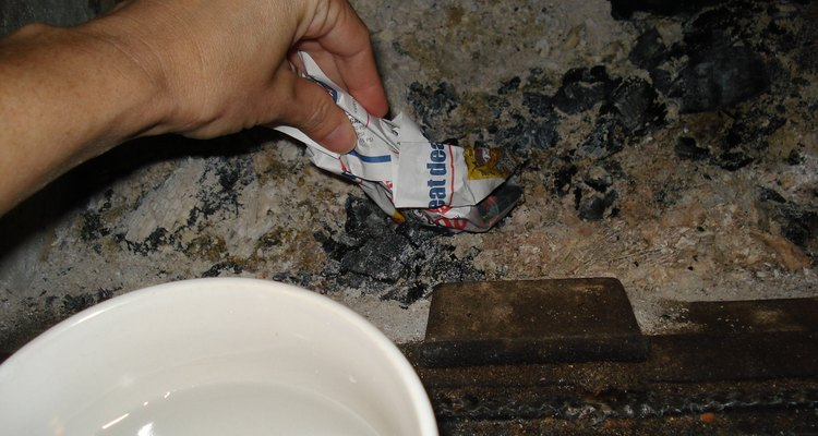 Moist newspaper dipped in ash
