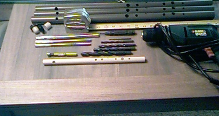 The raw materials and a finished PVC flute