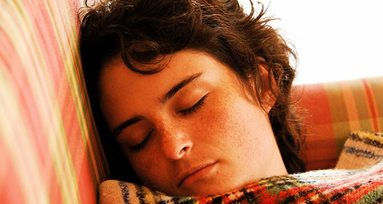 A woman sleeps peacefully before being awakened by her alarm clock