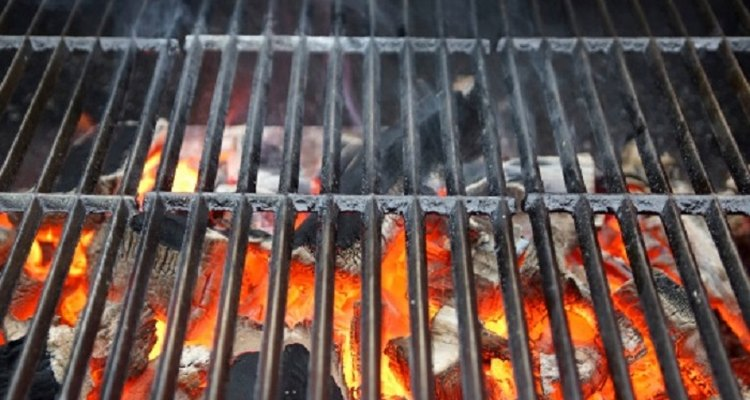 Charcoal grill construction can be simple as laying grates across breeze blocks.