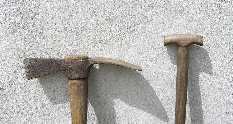 You'll need heavy duty tools to break up concrete slab.