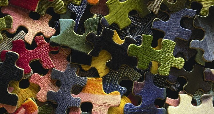 Preserve jigsaw puzzles by sticking them together with glue.