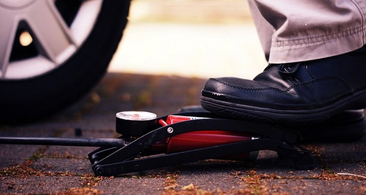 Fix a flat tyre with a foot pump.