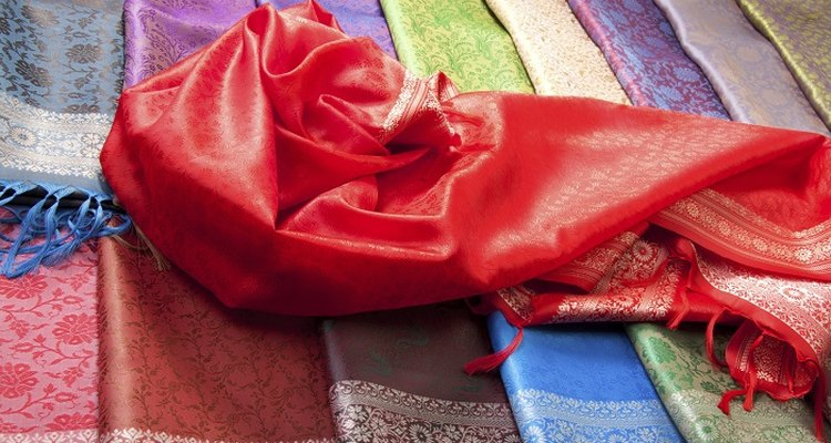 Stop satin from fraying immediately to prevent the fabric unravelling.