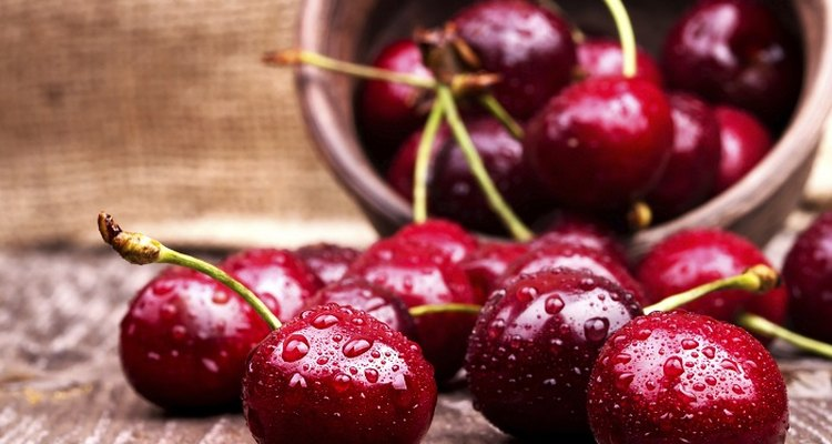 Picking cherries can lead to badly stained hands.