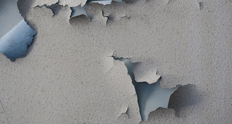 Flaky paint on interior walls is unsightly and prevents new paint from sticking properly.