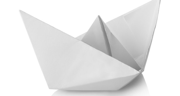 Fold paper into a hat shape.