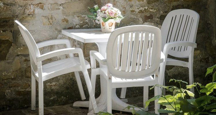 Clean white plastic outdoor furniture to keep it attractive.