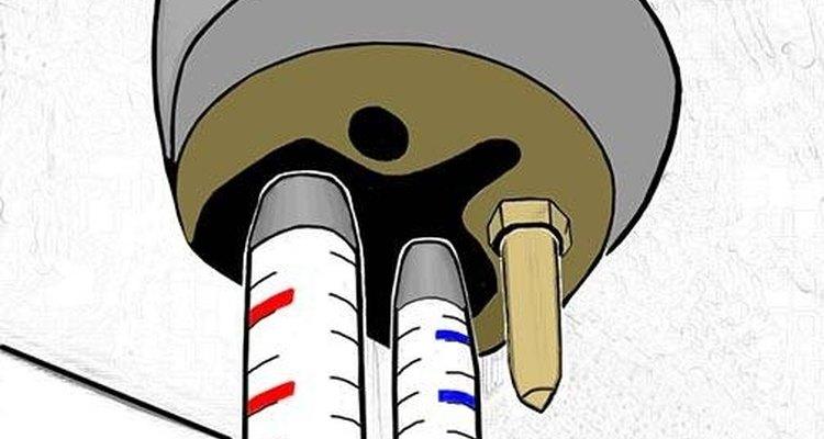 Prenda o parafuso de montagem no buraco correspondente por baixo do corpo da torneira