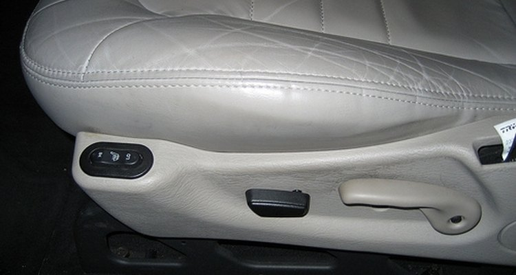You can repair cracked leather car seats with a few items from an automotive paint store.
