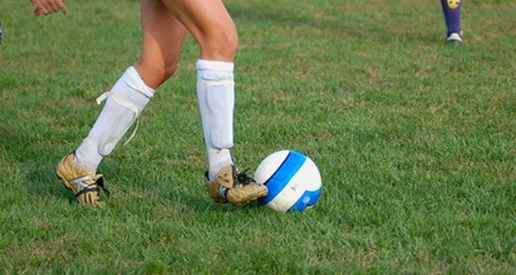 Soccer cleats are designed to allow the shoe to grip the grass, preventing you from excessively sliding or falling.