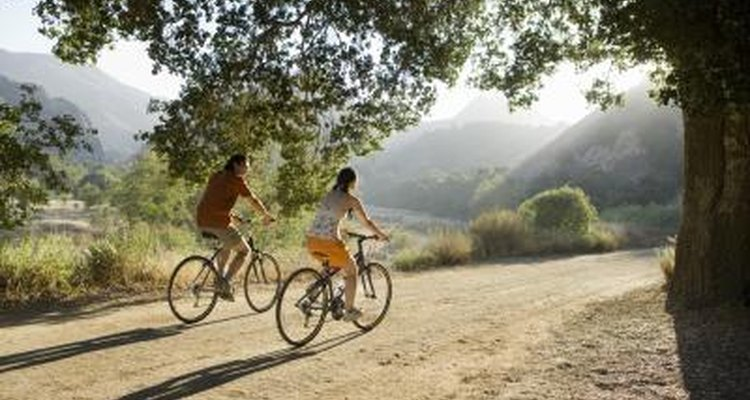 Young couple riding bicycles.