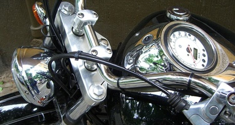 Loosen the lower bolts on the handlebar's risers and adjust the bars forward or back until comfortable.