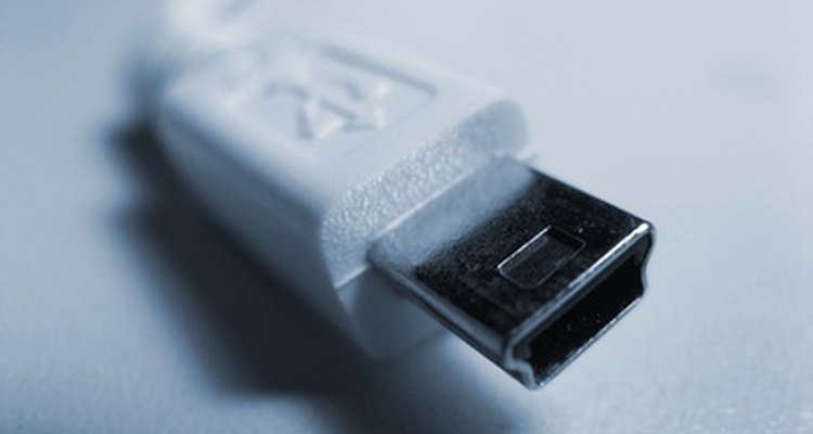 A USB cable is used to connect to iTunes.