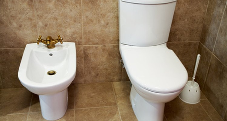 A traditional bidet and toilet set-up.