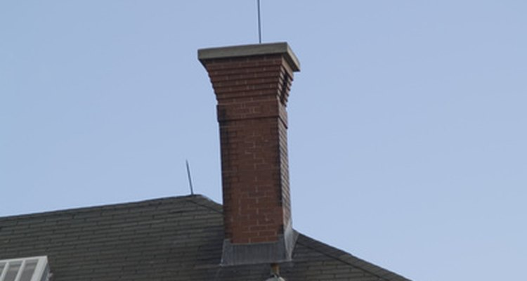 The chimney flashing blocks water from entering through the seam where the chimney meets the roof