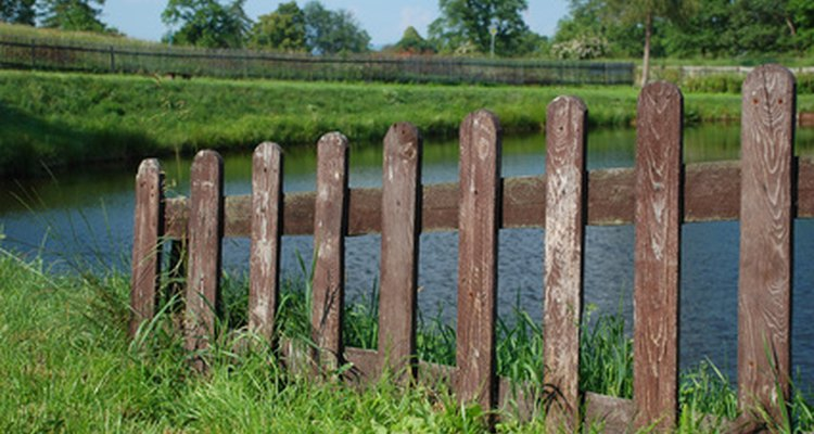 Spaced picket fences allow wind to pass through the slats.